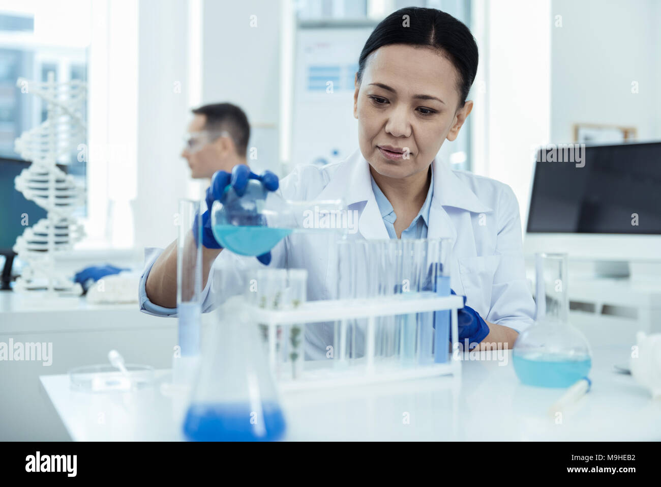 Serious scientist making an important experiment - Stock Image