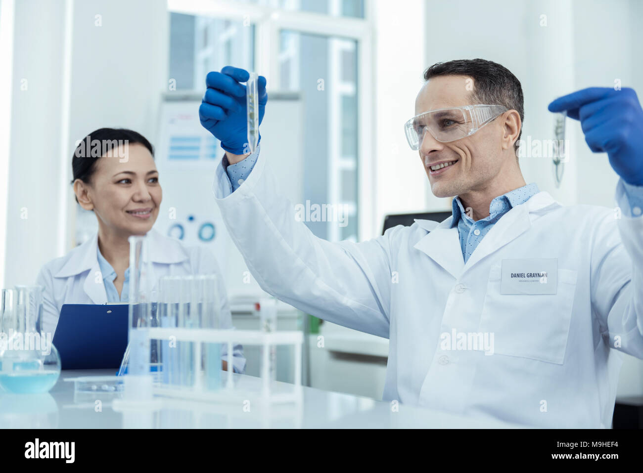 Enthusiastic scientists having an experiment - Stock Image