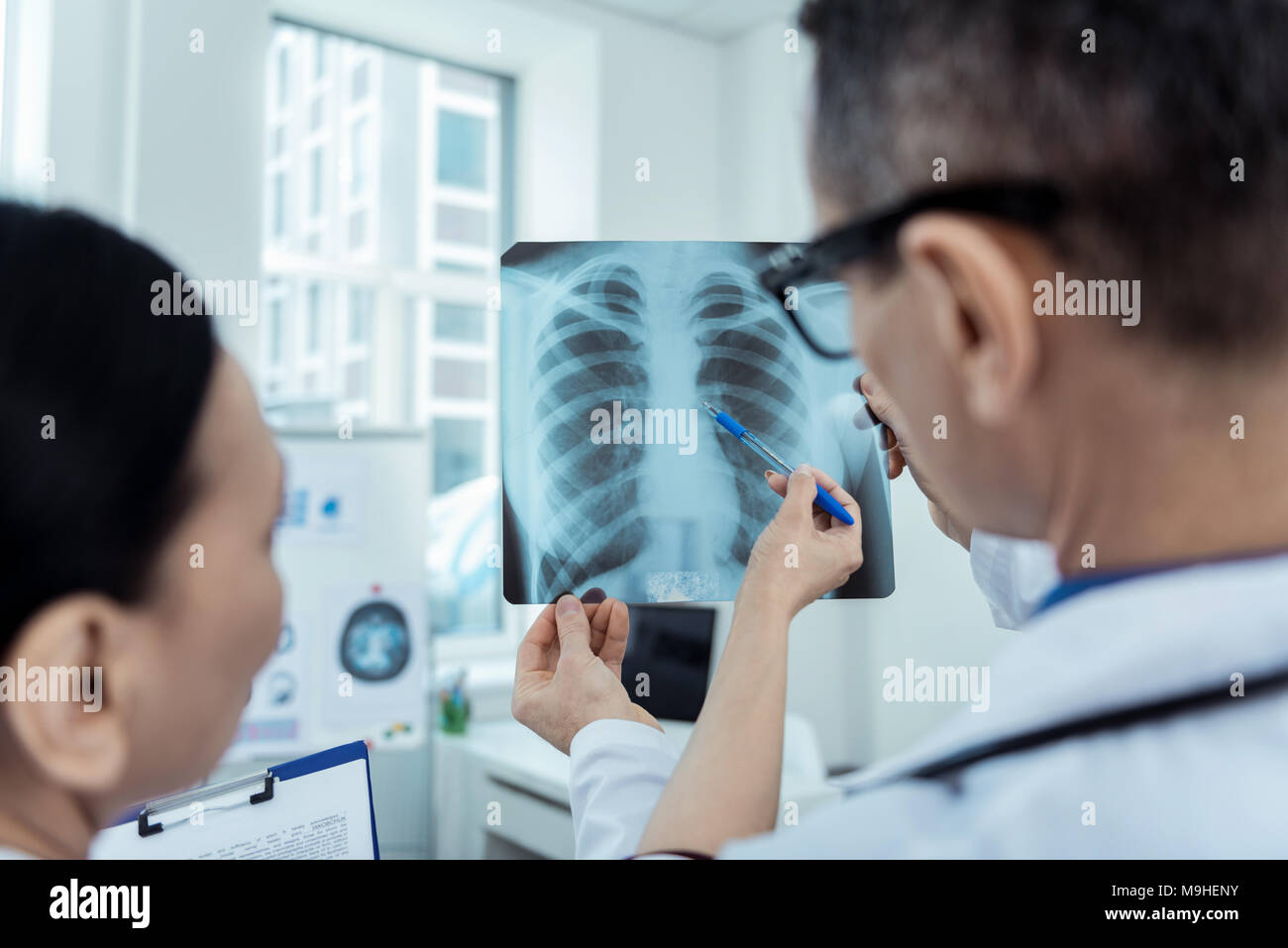 Experienced doctors detecting problems on radio scan - Stock Image