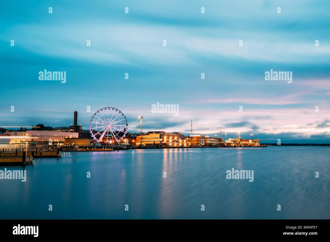 Helsinki, Finland. View Of Embankment With Ferris Wheel In Evening Night Illuminations. - Stock Image