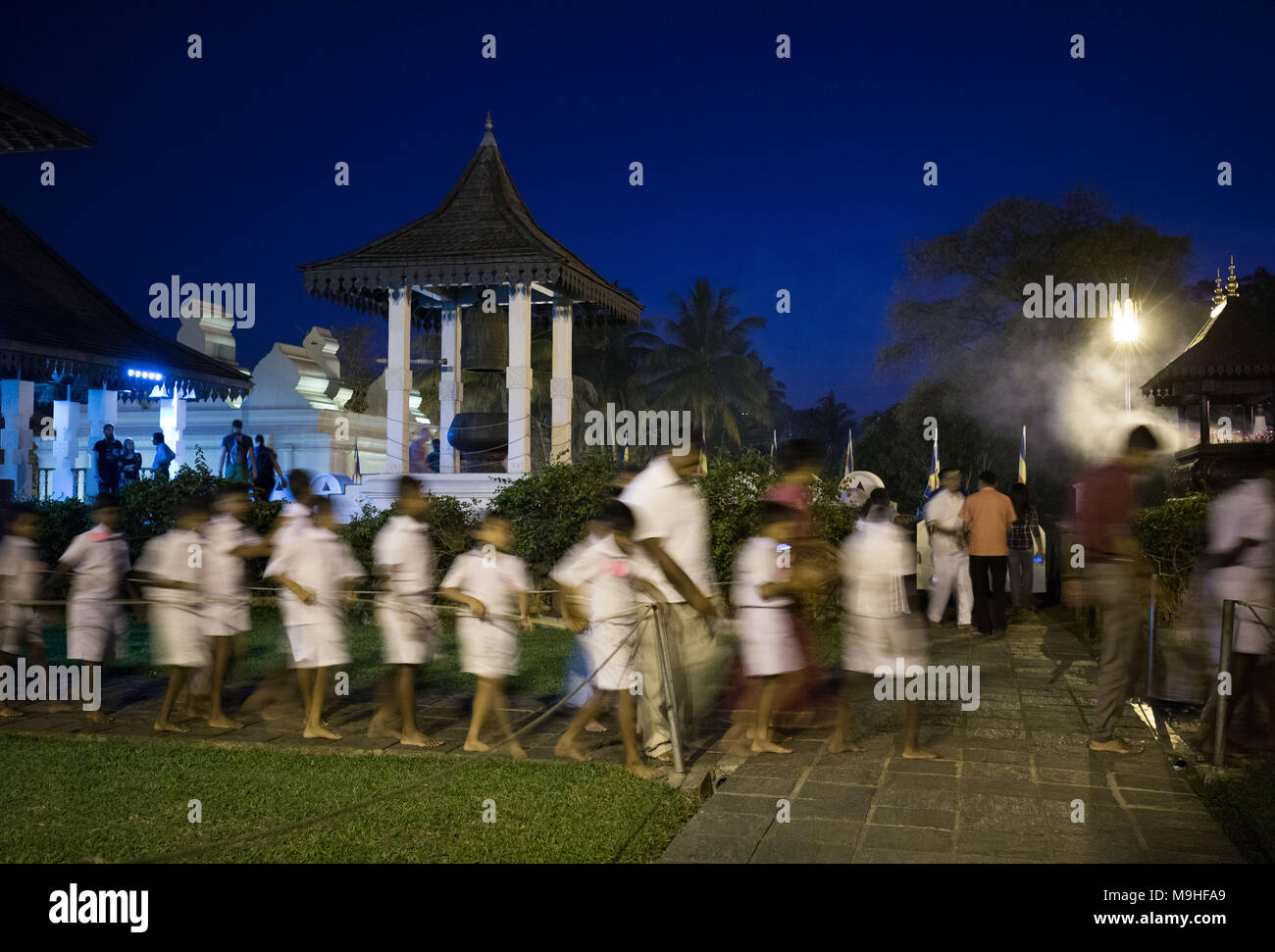 School students walking in a queue at Temple of the Tooth, Kandy, Sri Lanka, Asia. - Stock Image