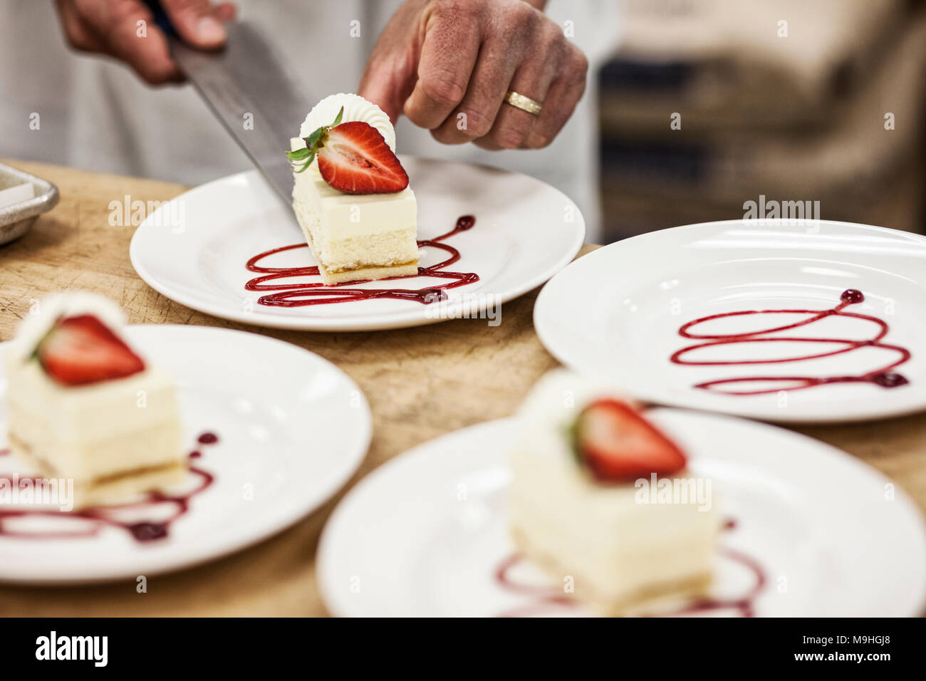 Chef Hands Placing A Layered Desert On A Plate Presentation Of A Sweet Dish Stock Photo Alamy