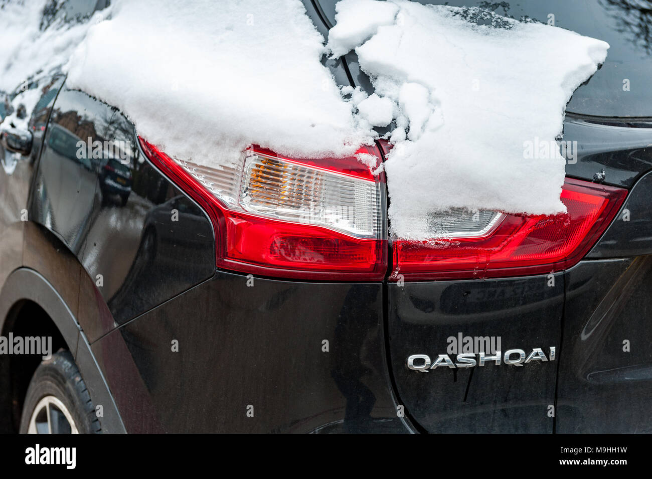 Nissan Qashqai covered in snow during Storm Emma, parked in Coventry, West Midlands, UK. - Stock Image
