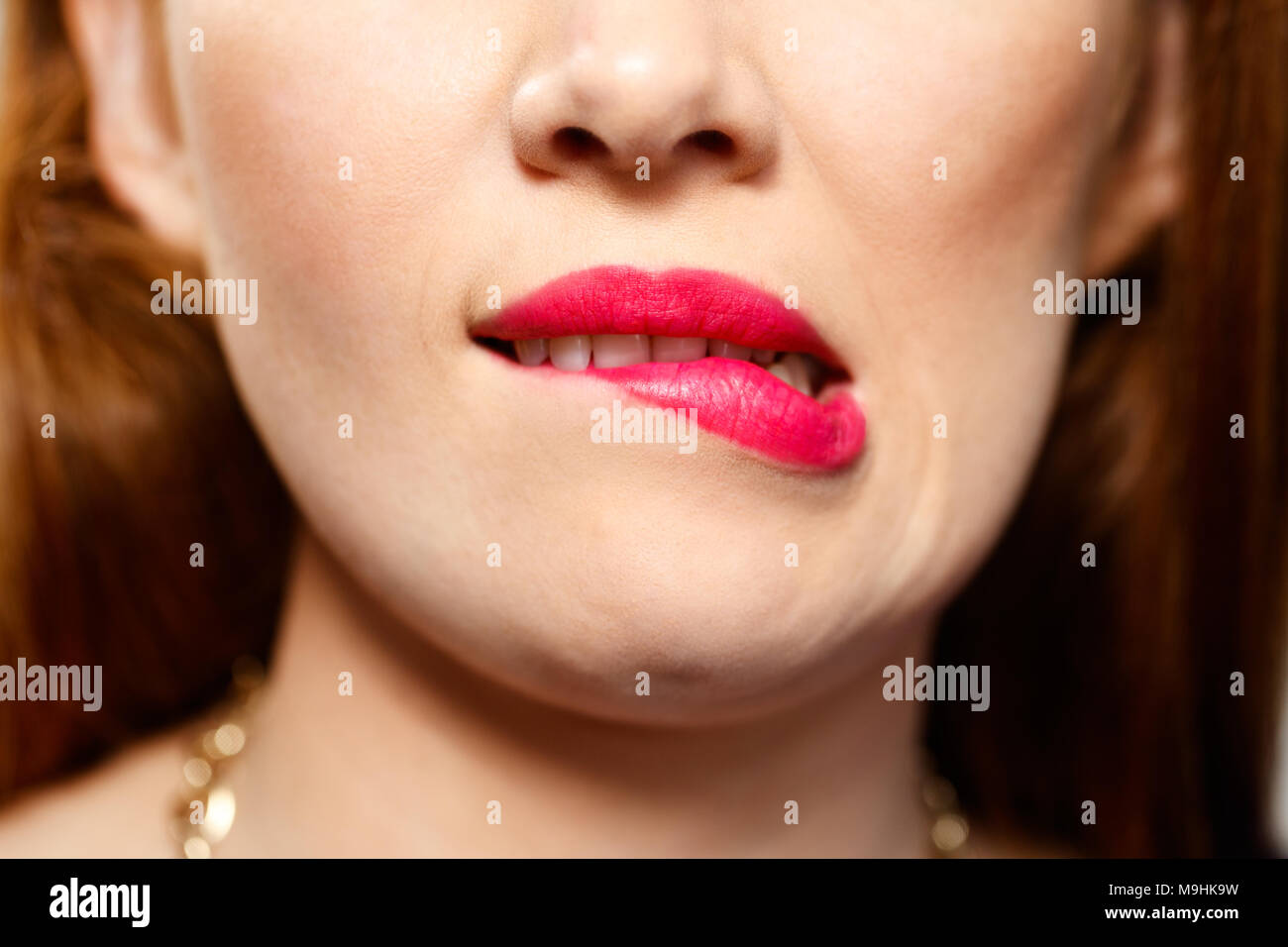 Facial Expressions Of Young Redhead Woman Closeup - Stock Image