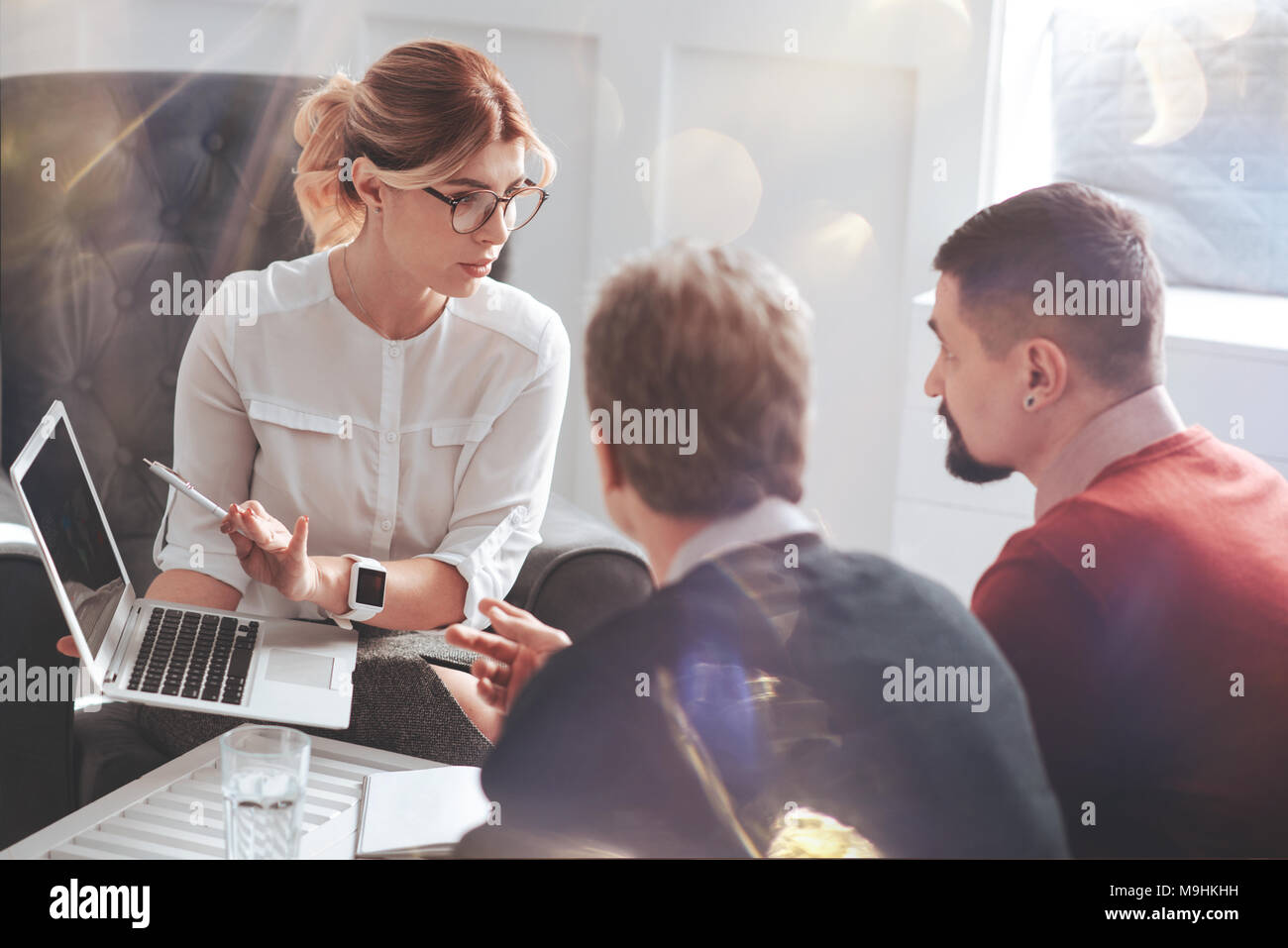 Good looking attractive businesswoman pointing at the laptop screen - Stock Image