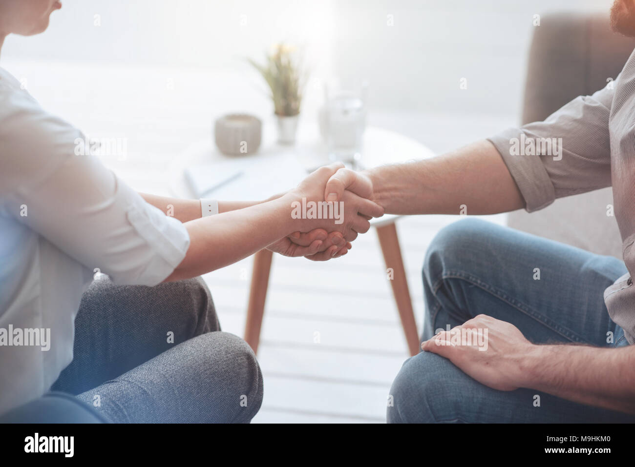 Pleasant friendly people shaking hands - Stock Image