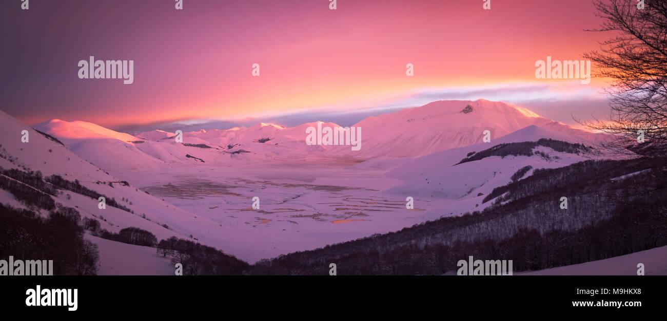 Sibillini Mountains at sunrise, Castelluccio di Norcia village, Umbria, Italy - Stock Image