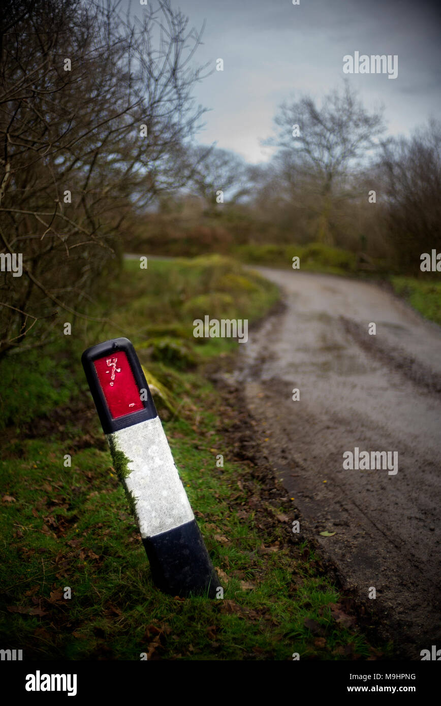 roadside road edge marker a reflective post on moorland country lane - Stock Image