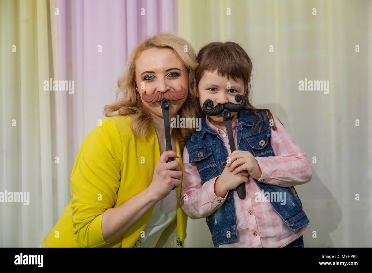 Woman with toy mustache - Stock Image
