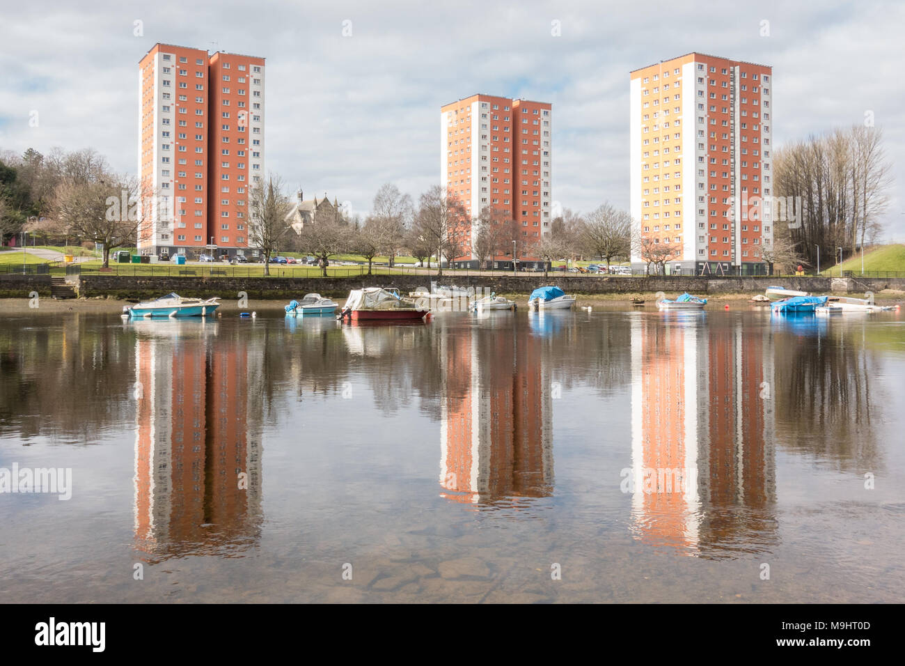 High Rise flats reflected in the River Leven, West Bridgend, Dumbarton, Scotland, UK - Stock Image