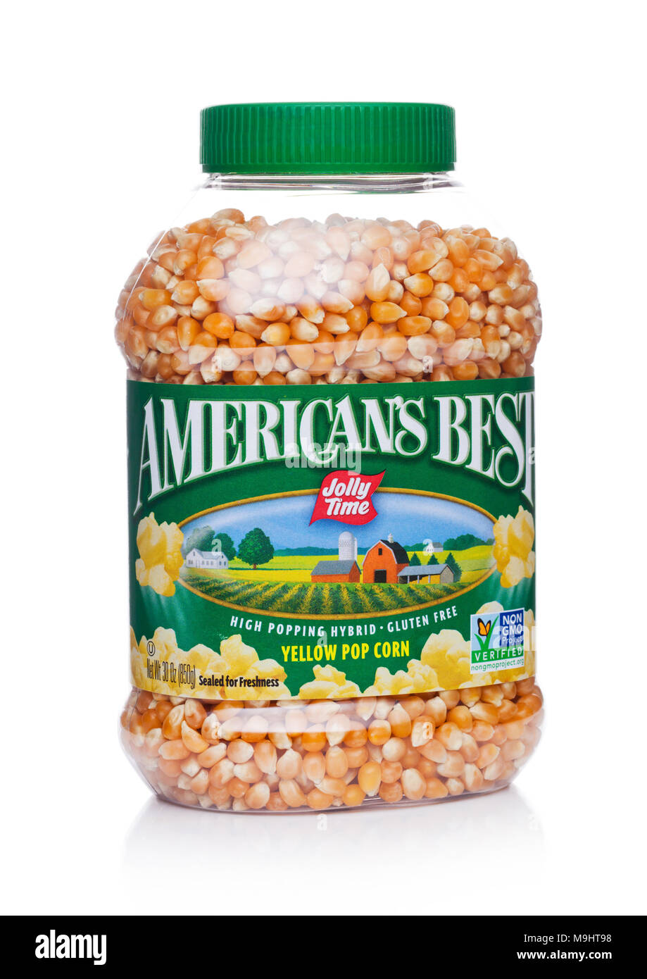 LONDON, UK -MARCH 22, 2018: Plastic jar of Jolly Time America's Best yellow popcorn on white background. - Stock Image
