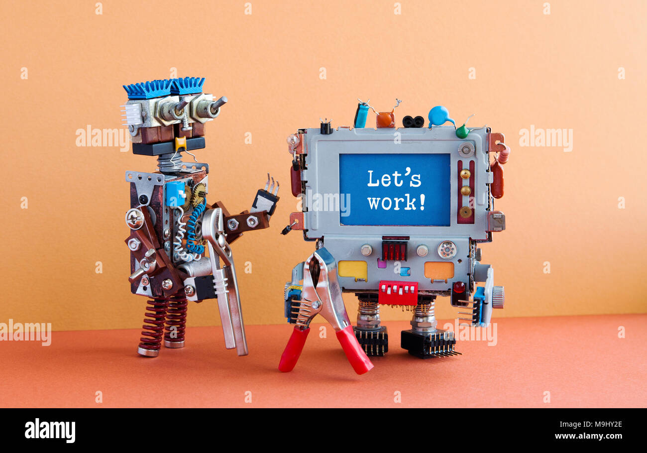 4th industrial revolution robotic auomation concept. Two handyman robots characters, brown wall red floor background. Creative design mechanic toys with pliers, message Let's work on blue screen - Stock Image