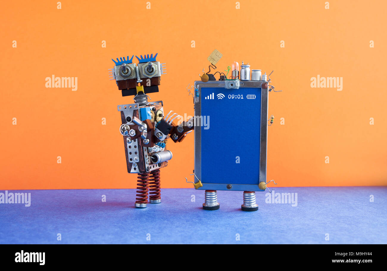 Mobile smartphone gadget robot assistant. Funny robotic toy characters, creative design touch screen phone device, light bulb capacitors sim card. Blank blue display copy space. Orange wall, blue floor background. - Stock Image