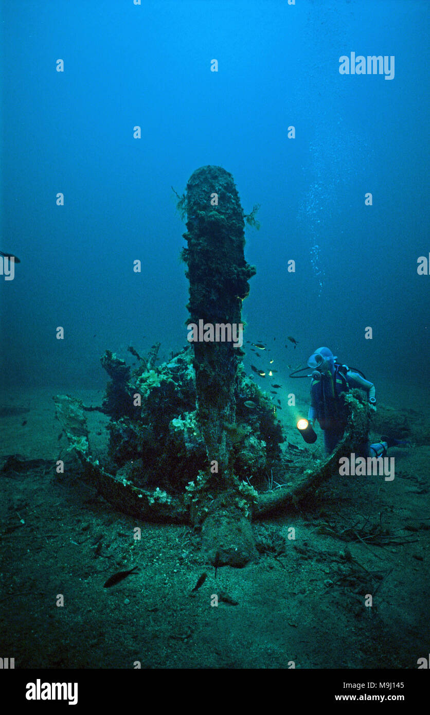 Scuba diver at the motor of a american fighter plane P 47 Thunderbolt, sunken, 2nd world war, Corsica, France, Mediterranean sea, Europe - Stock Image
