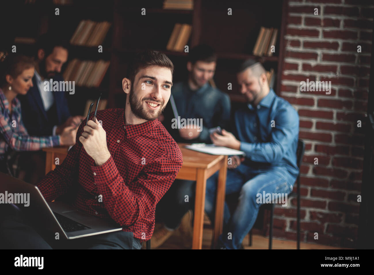 officer of the company with laptop on the background  business - Stock Image