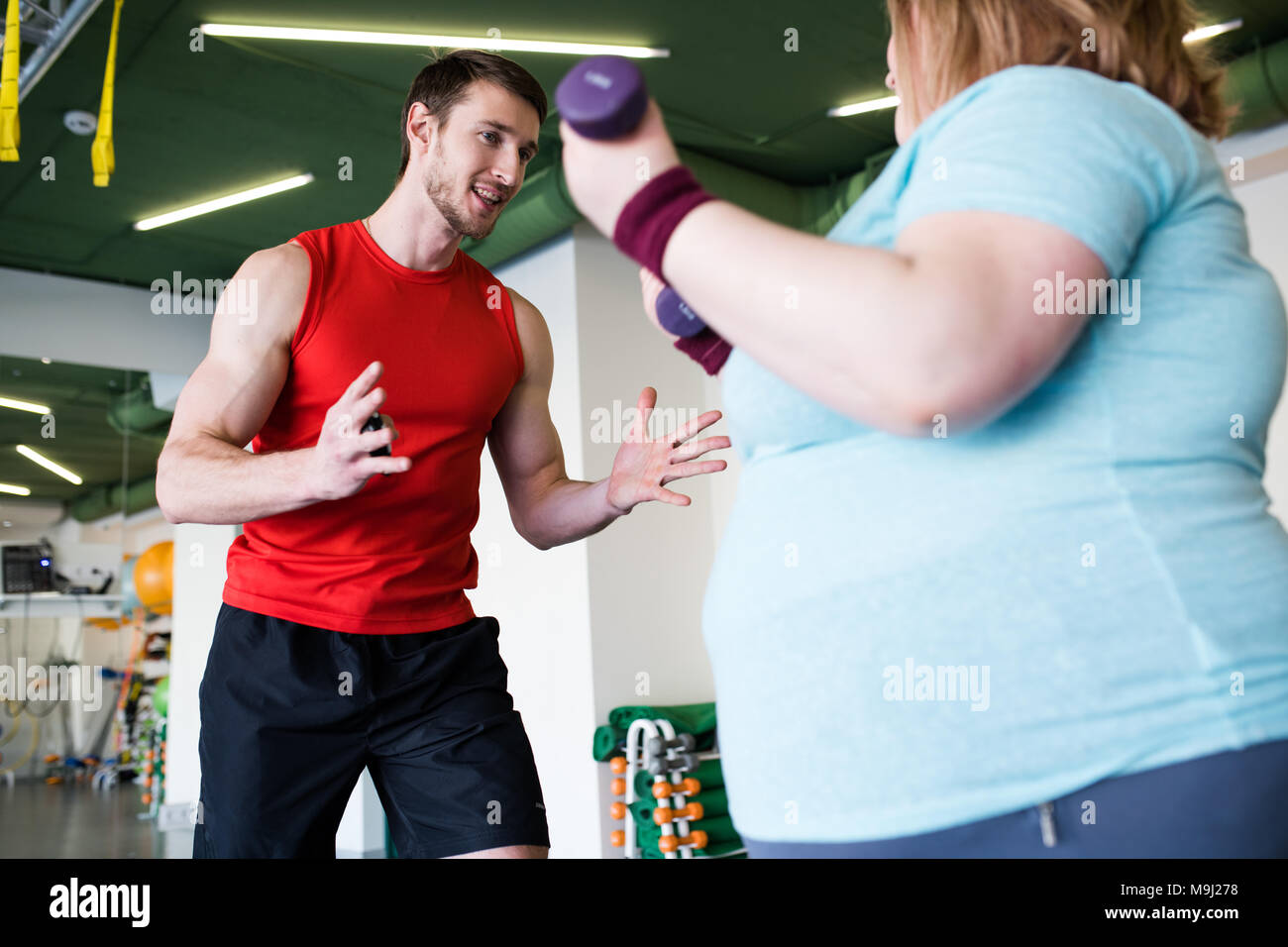 Personal Trainer Working with Client - Stock Image