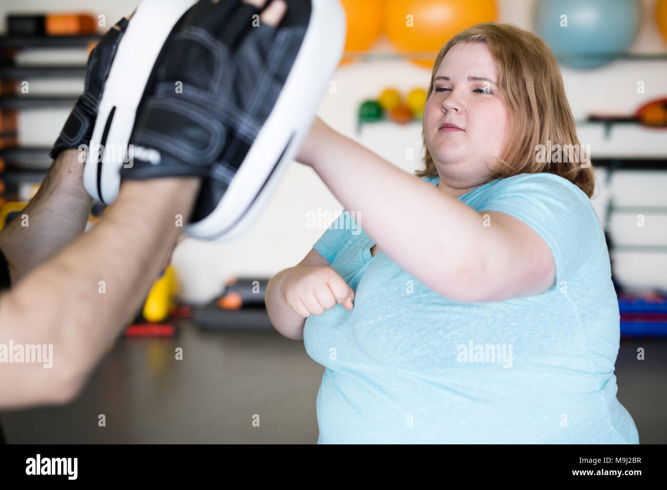 Obese Woman in Boxing Practice - Stock Image