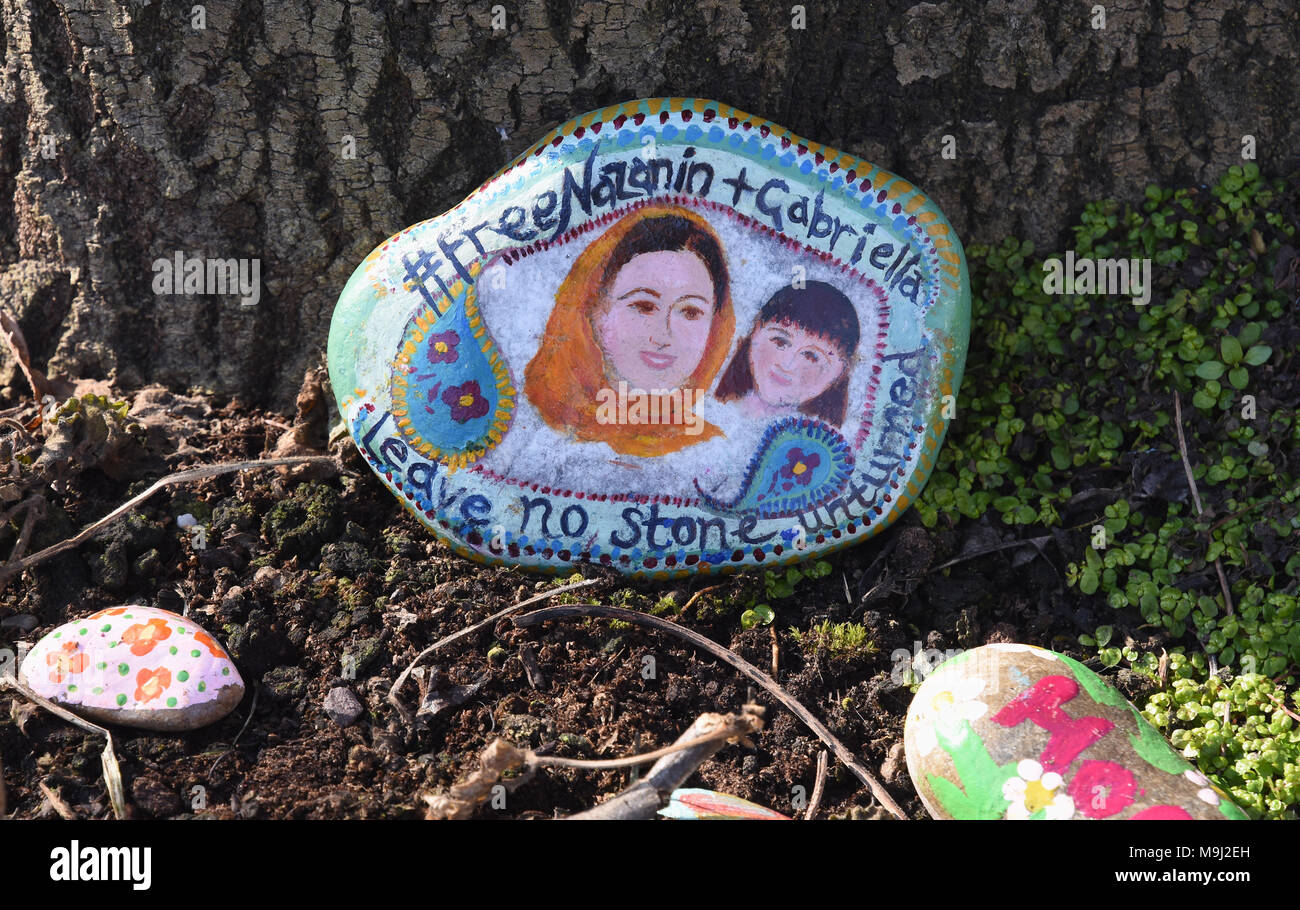 Campaigners to free Nazanin Zachary-Ratcliffe left painted pebbles outside of the Foreign Office on 10.03.18 to draw attention to her plight. - Stock Image