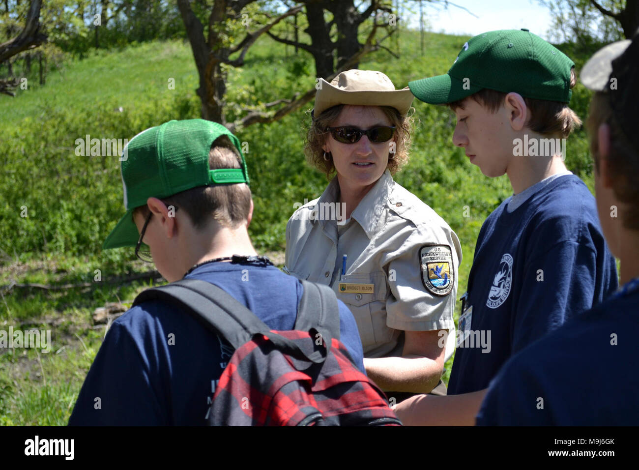 Litchfield Wetland Management District Wildlife Refuge Specialist Bridget Olson taught scouts about the concept of vectors. Photo by Tina Shaw/USFWS. - Stock Image