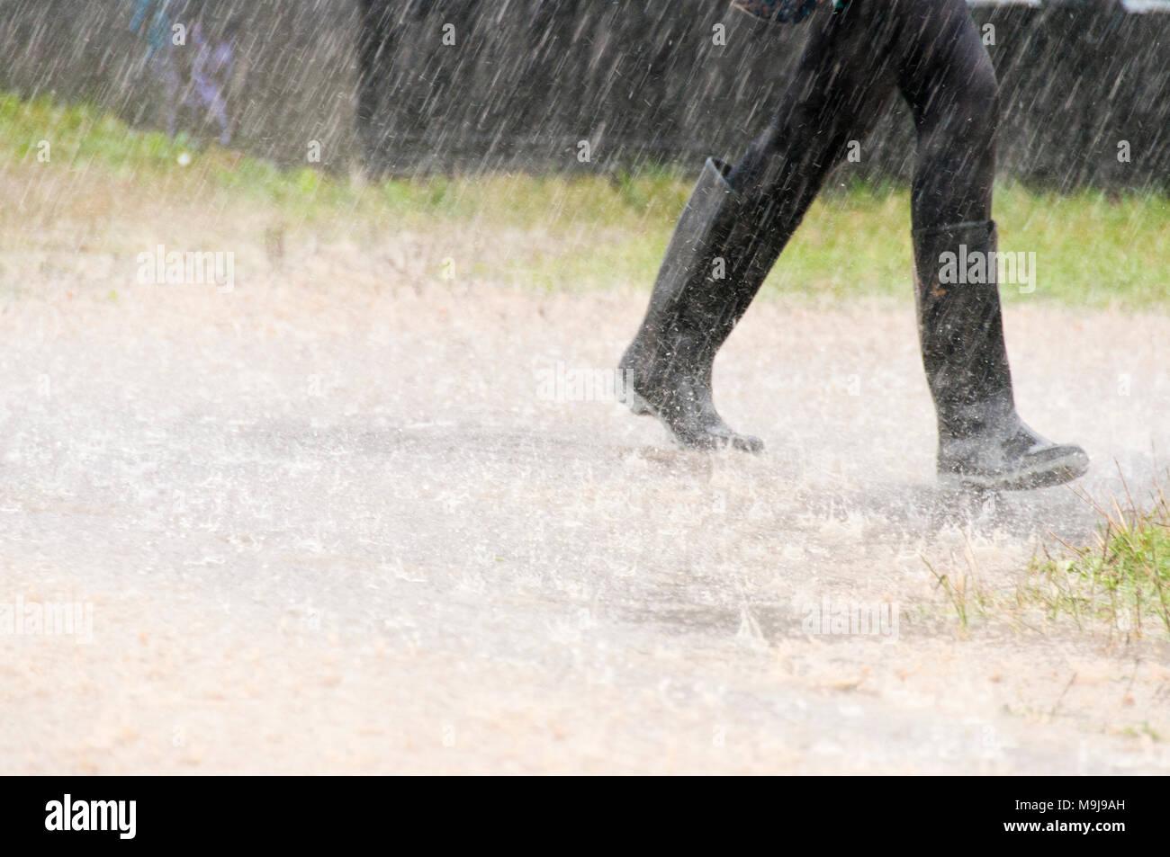 Wellies in the rain - Stock Image
