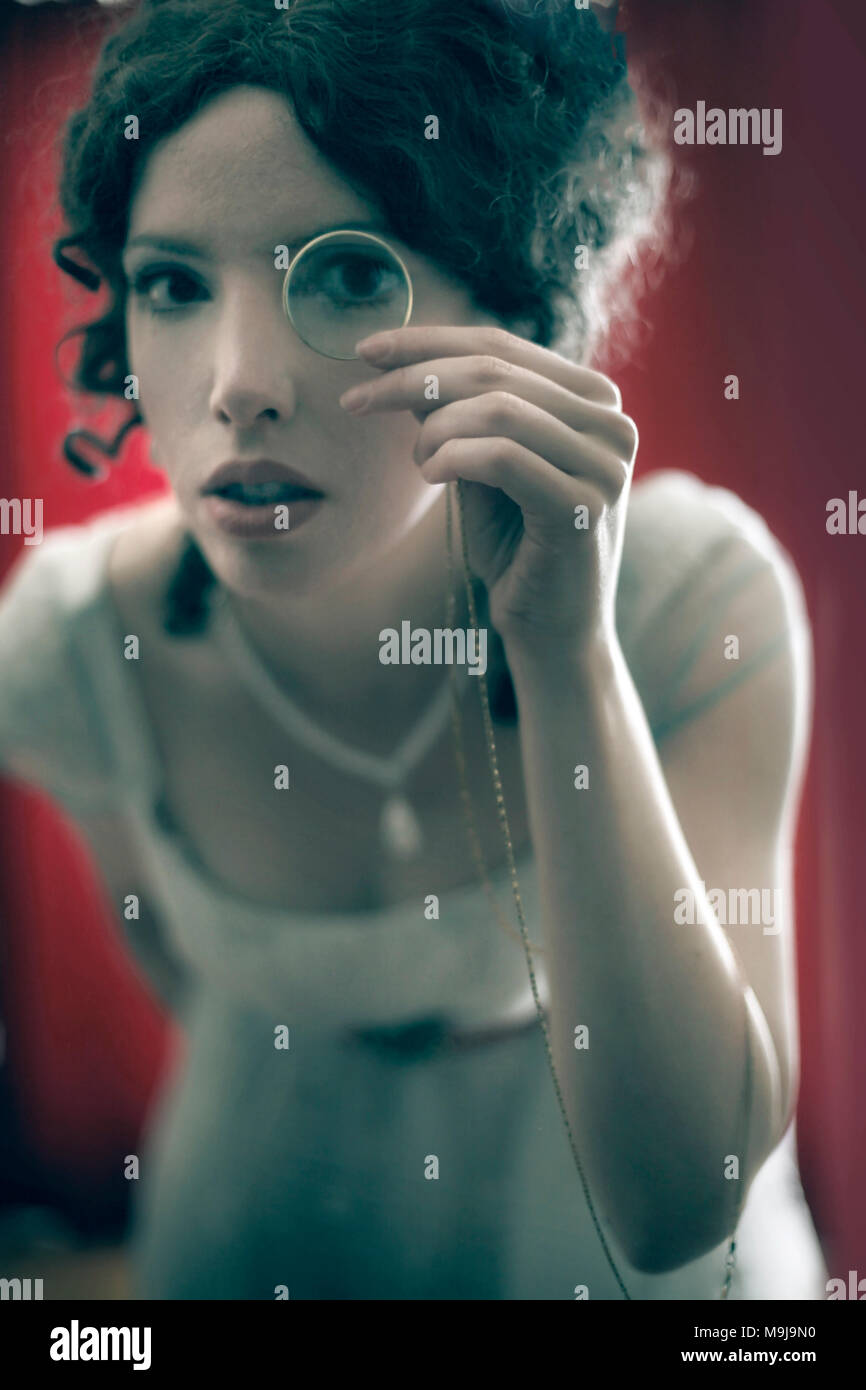 woman with magnifying glass - Stock Image