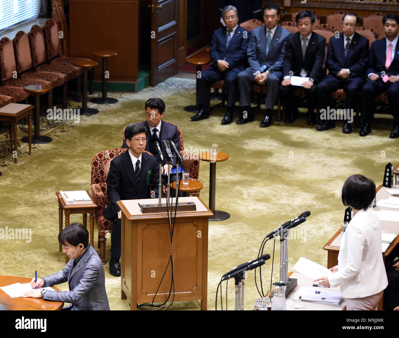 (180327) -- TOKYO, March 27, 2018 (Xinhua) -- Former head of the National Tax Agency Nobuhisa Sagawa (C L) appears as a sworn witness in the Diet, Japan's bicameral legislature, in Tokyo, Japan, March 27, 2018. A key figure in a document-tampering scandal involving Japan's Finance Ministry appeared in the Diet on Tuesday to give sworn testimony over the falsification of government documents related to the heavily discounted sale of state land to a nationalist school operator. Former national tax agency head Nobuhisa Sagawa, who was previously in charge of taking care of the land sale, stepped  - Stock Image