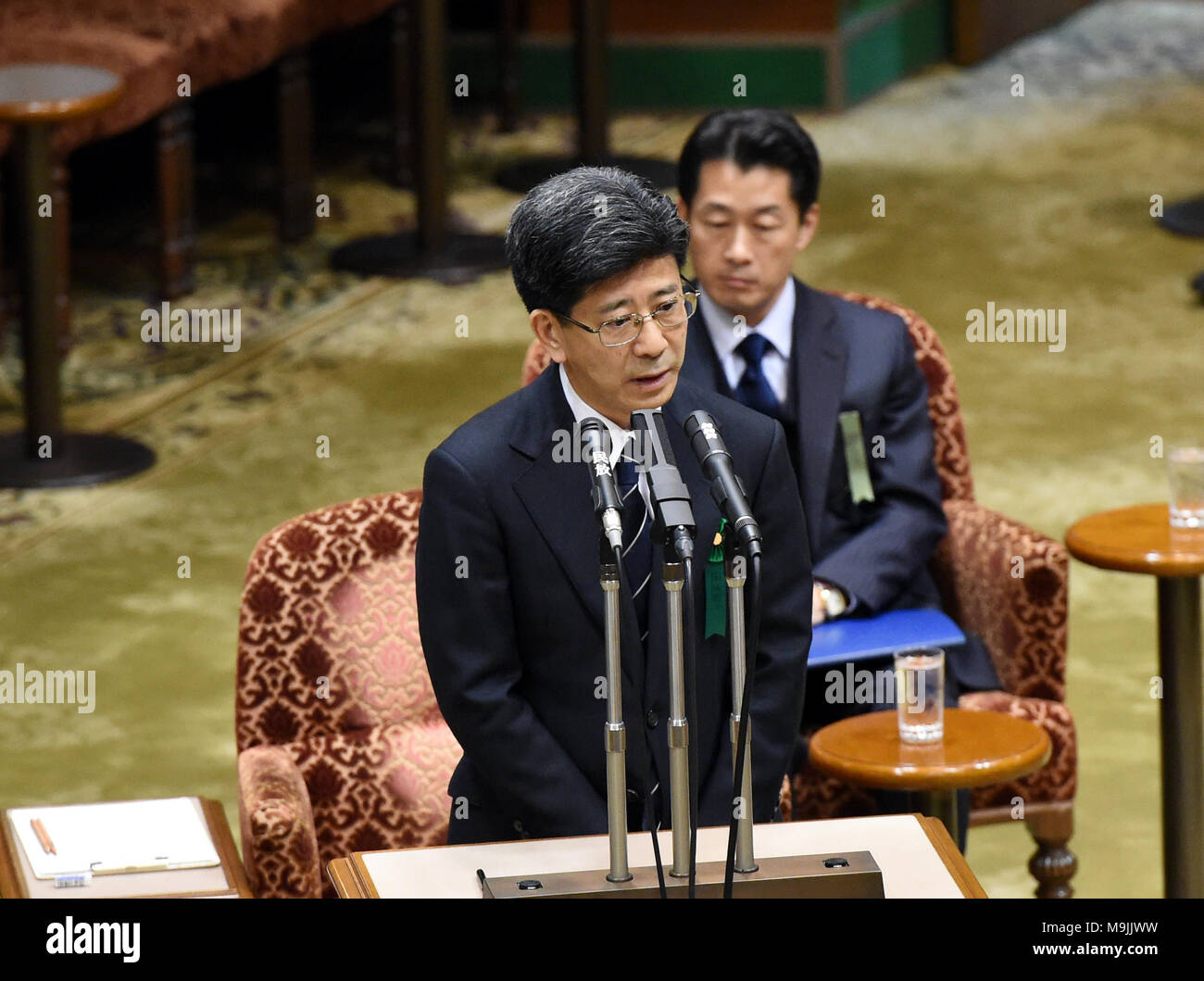 (180327) -- TOKYO, March 27, 2018 (Xinhua) -- Former head of the National Tax Agency Nobuhisa Sagawa (front) appears as a sworn witness in the Diet, Japan's bicameral legislature, in Tokyo, Japan, March 27, 2018. A key figure in a document-tampering scandal involving Japan's Finance Ministry appeared in the Diet on Tuesday to give sworn testimony over the falsification of government documents related to the heavily discounted sale of state land to a nationalist school operator. Former national tax agency head Nobuhisa Sagawa, who was previously in charge of taking care of the land sale, steppe - Stock Image