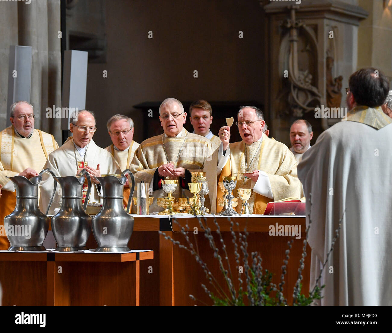 27 March 2018, Germany, Erfurt: An oil consecration mass taking place at the Erfurt Cathedral with suffragan bishop Reinhard Hauke (4-L) and bishop Ulrich Neymeyr (6-L). The bishop celebrates mass with priests of his diocese. The anointment with oil is intended to express an abundance of blessings, power and healing. Photo: Jens Kalaene/dpa - Stock Image