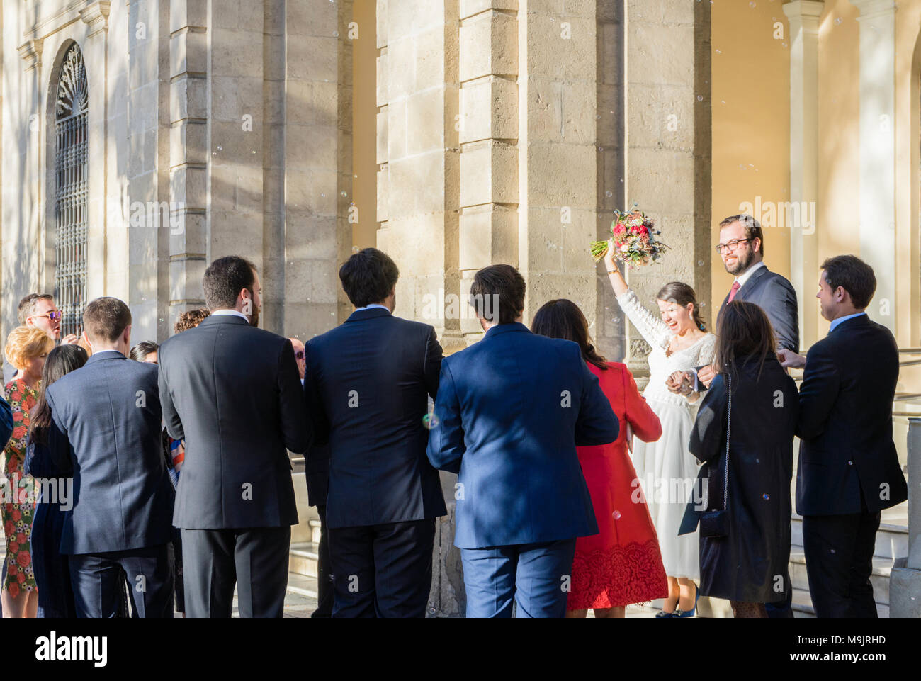 Newly married/ wed couple coming out of the registry office at the Town Hall in Seville 2018, Andalusia, Spain - Stock Image