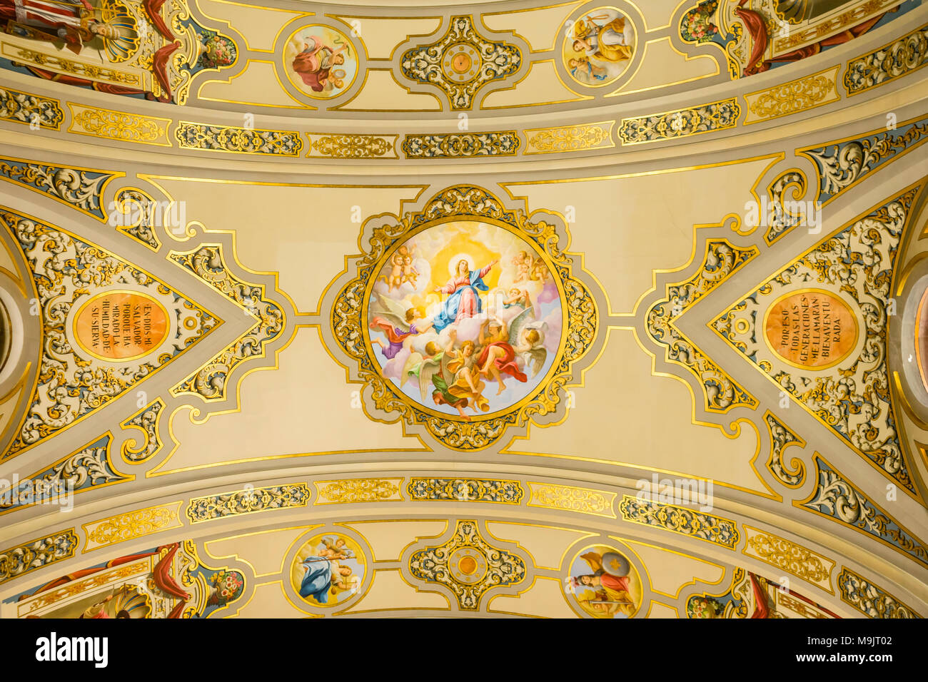 The colourful painted ceiling in neobaroque style in the Basilica de la Macarena (Macarena church) in the Spanish city of Seville, Andalusia, Spain - Stock Image