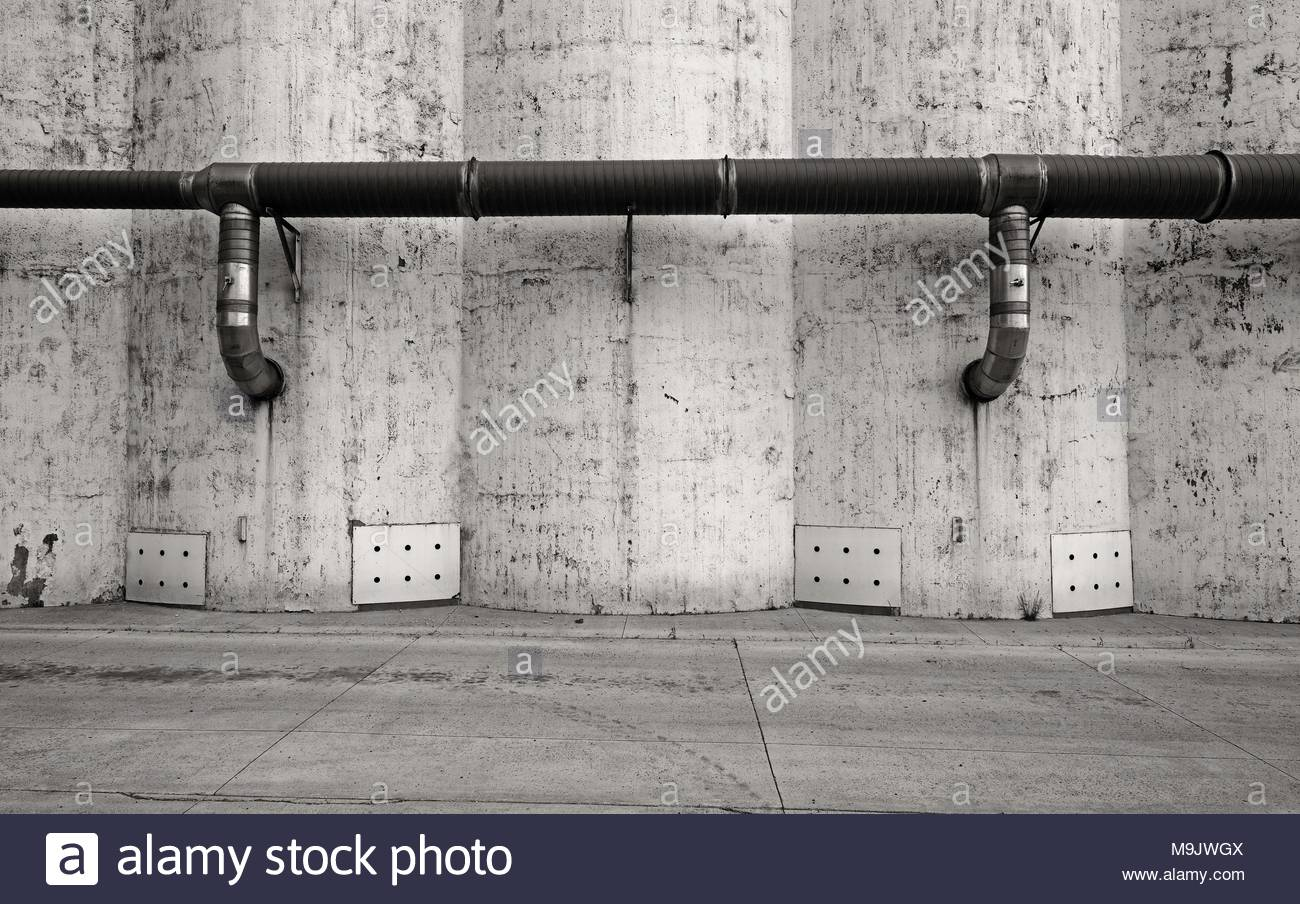 Abstract view of some concrete grain silos. - Stock Image