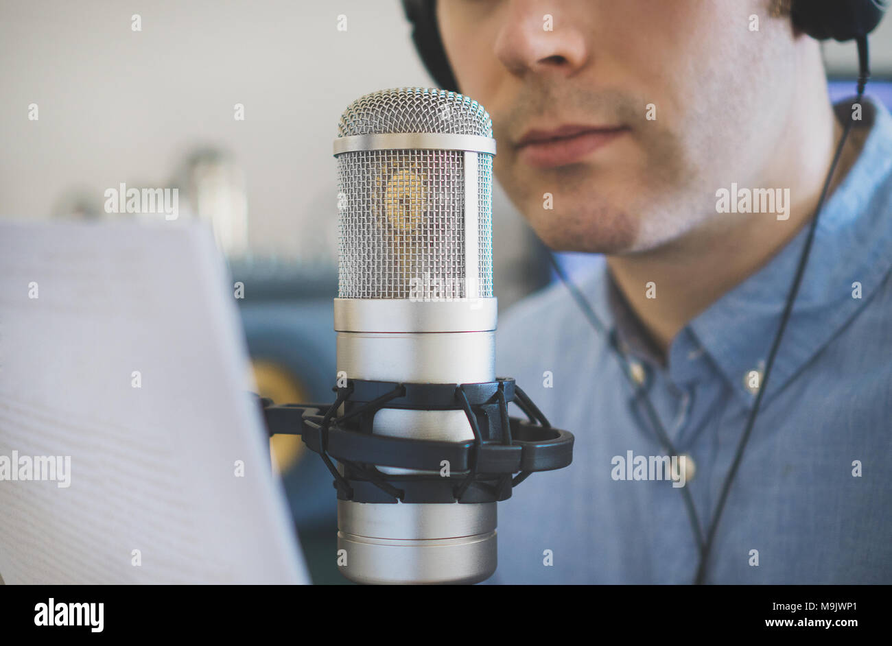 Man recording an advertisement on the radio station. - Stock Image