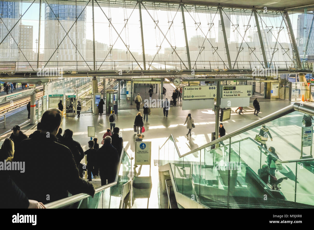 London, UK - February 16, 2018:  Concourse at Stratford Station, with people going down the escalator. - Stock Image