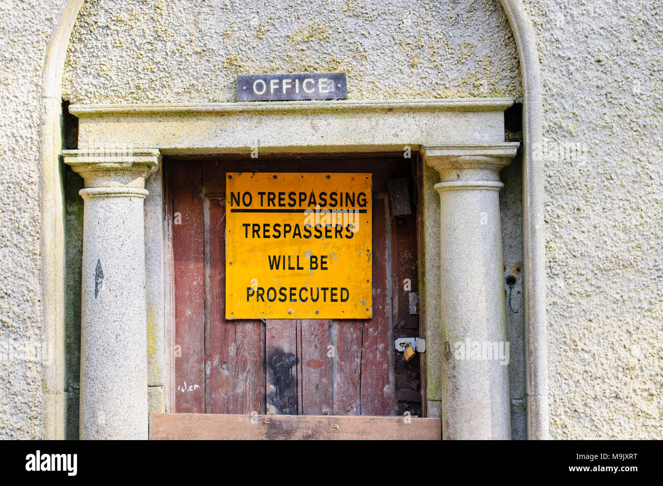 Sign at a building warning that trespassers will be prosecuted. - Stock Image