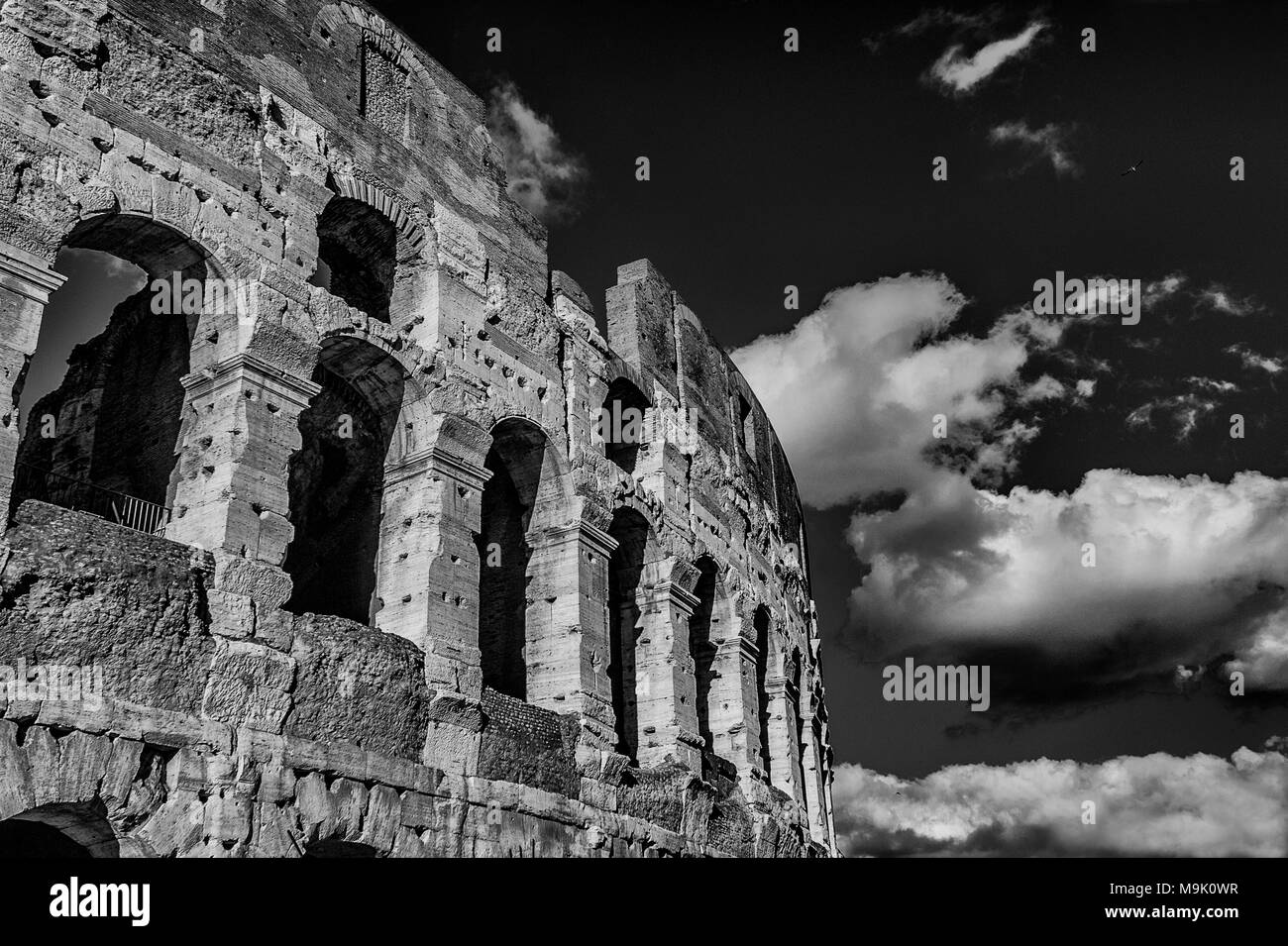 Coliseum inner ring monumental arcades with clouds in Rome (Black and White) - Stock Image