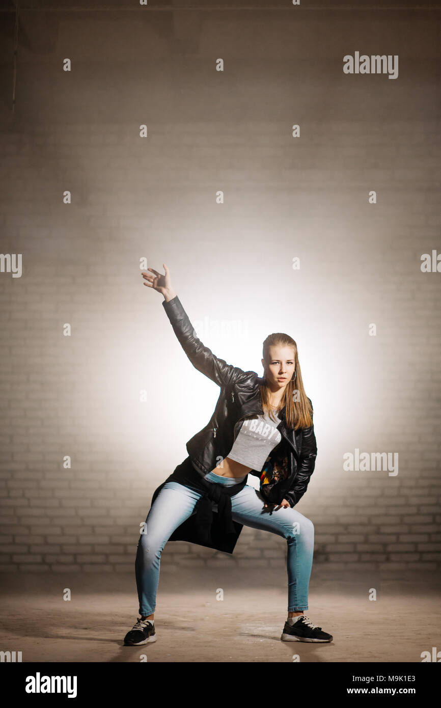 blondy lady with a sports figure dancing hip-hop outside.free time activities - Stock Image