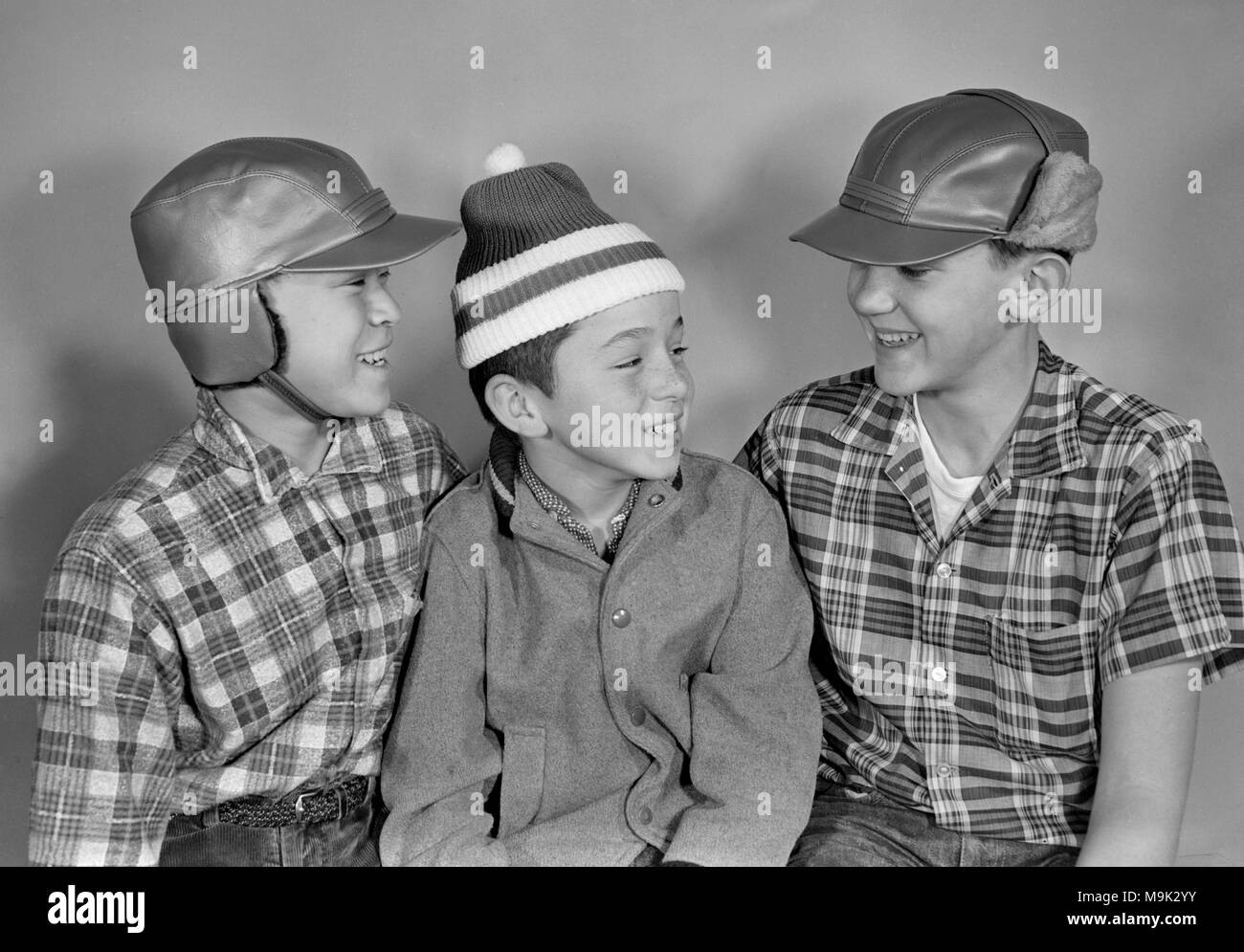 Three California pre-teen boys model period hats and clothes, ca. 1960. - Stock Image