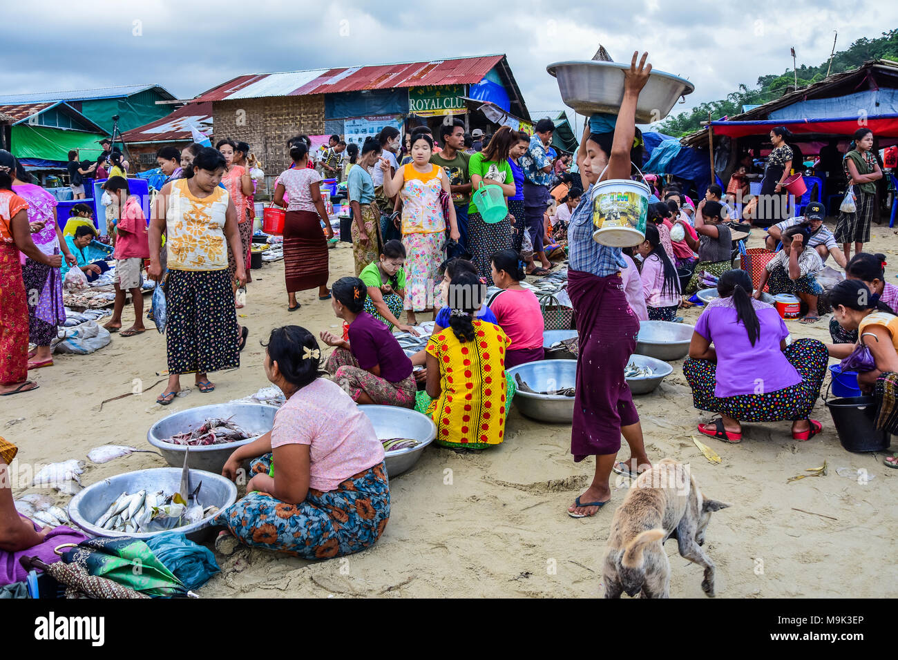 Dawei, Myanmar - July 12, 2015: Fresh market, where sellers and buyers meet to sell and buy fresh and raw food in Dawei, Myanmar - Stock Image