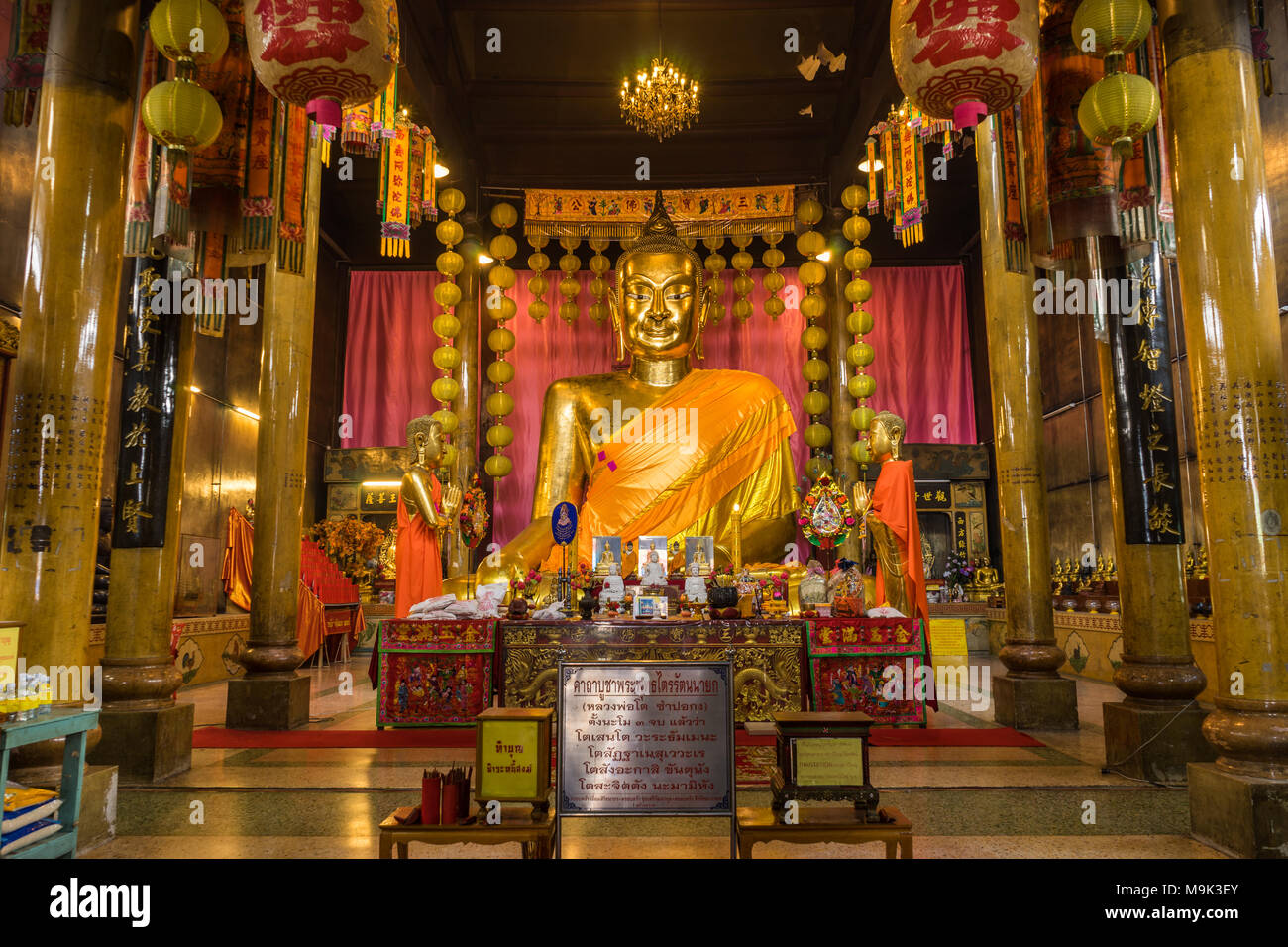 Chachoengsao, Thailand - September 24, 2016: Chinese golden Buddha Image in Chinese temple where Chinese Buddhist to worship in Chachoengsao, Thailand - Stock Image