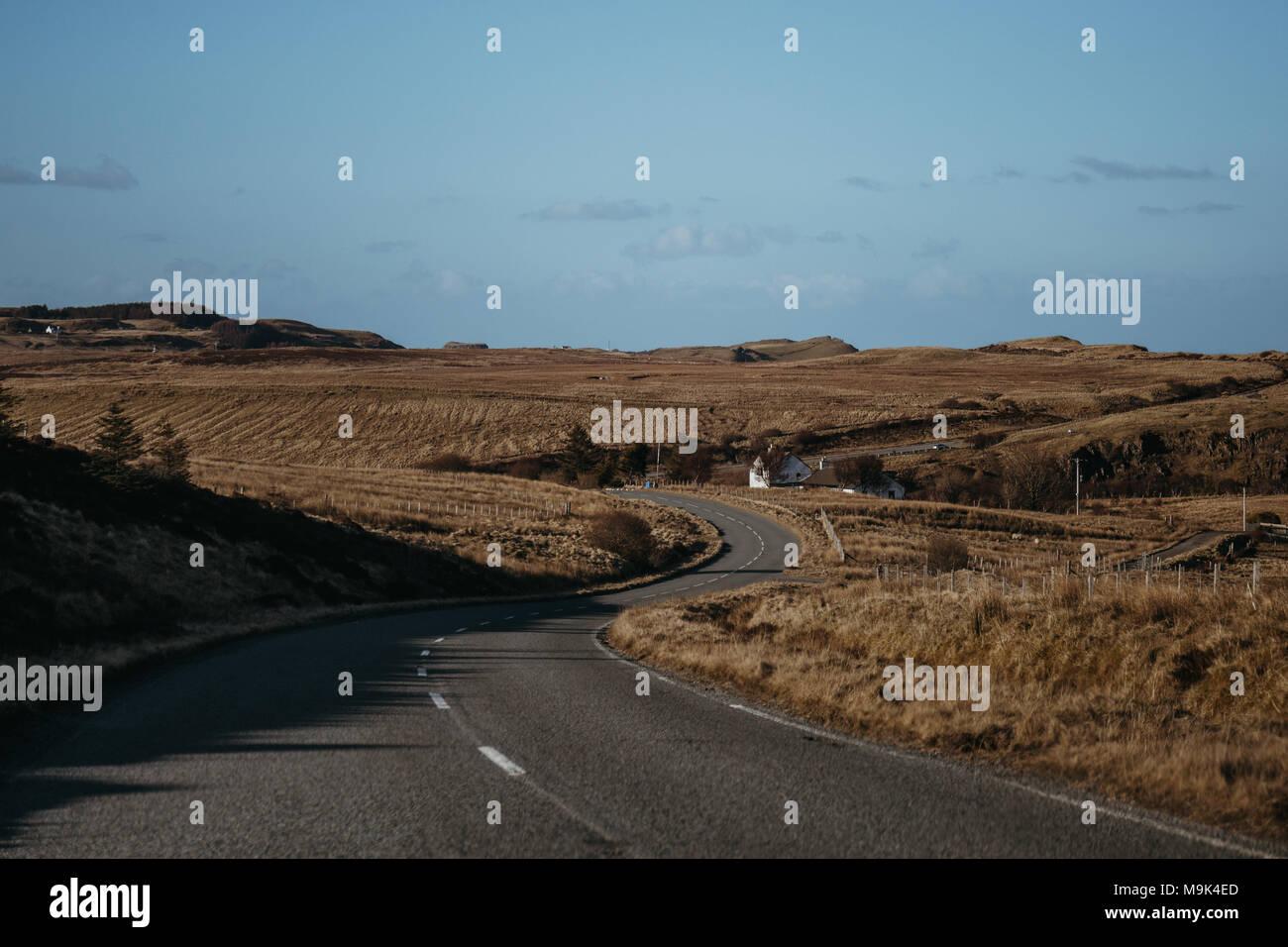 Road going through Isle of Skye, Scotland near Old Man of Storr. - Stock Image