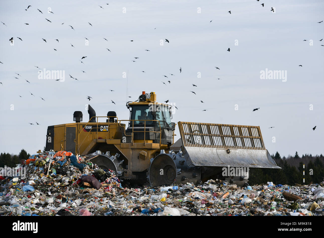 Moscow Oblast, Russia. 25 March, 2018. Bulldozer at the Yadrovo landfill site in Moscow Oblast, Russia. - Stock Image