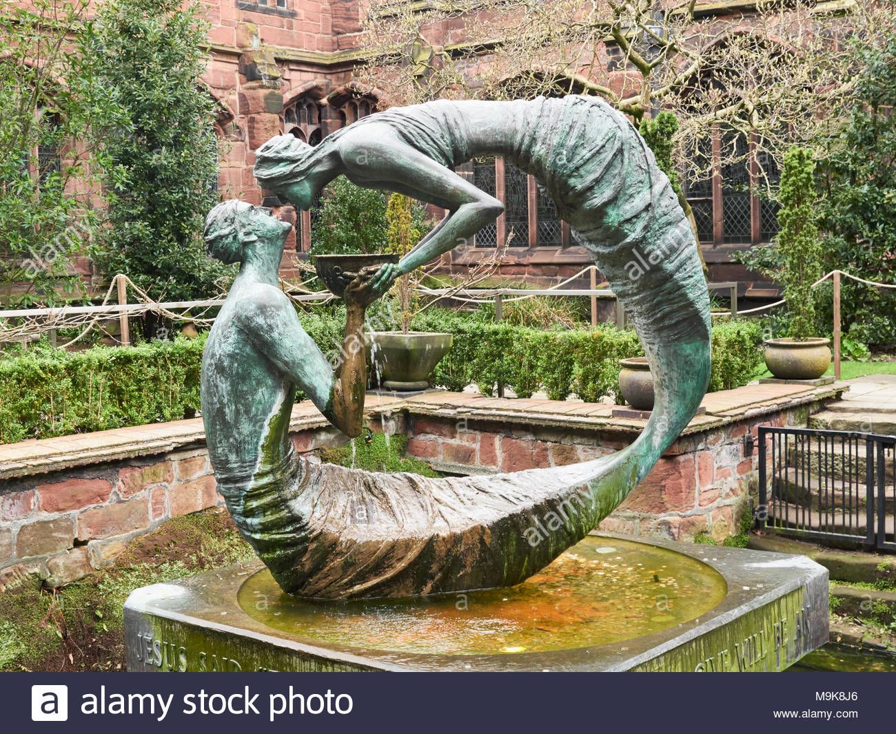 The water of life sculpture in cloister garth gardens in chester cathedral in cheshire england uk - Stock Image