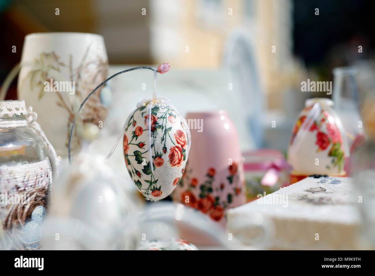 Decoupage technique. VIntage style. Shabby chic wooden boxes, glass jar and Easter egg. Stock Photo