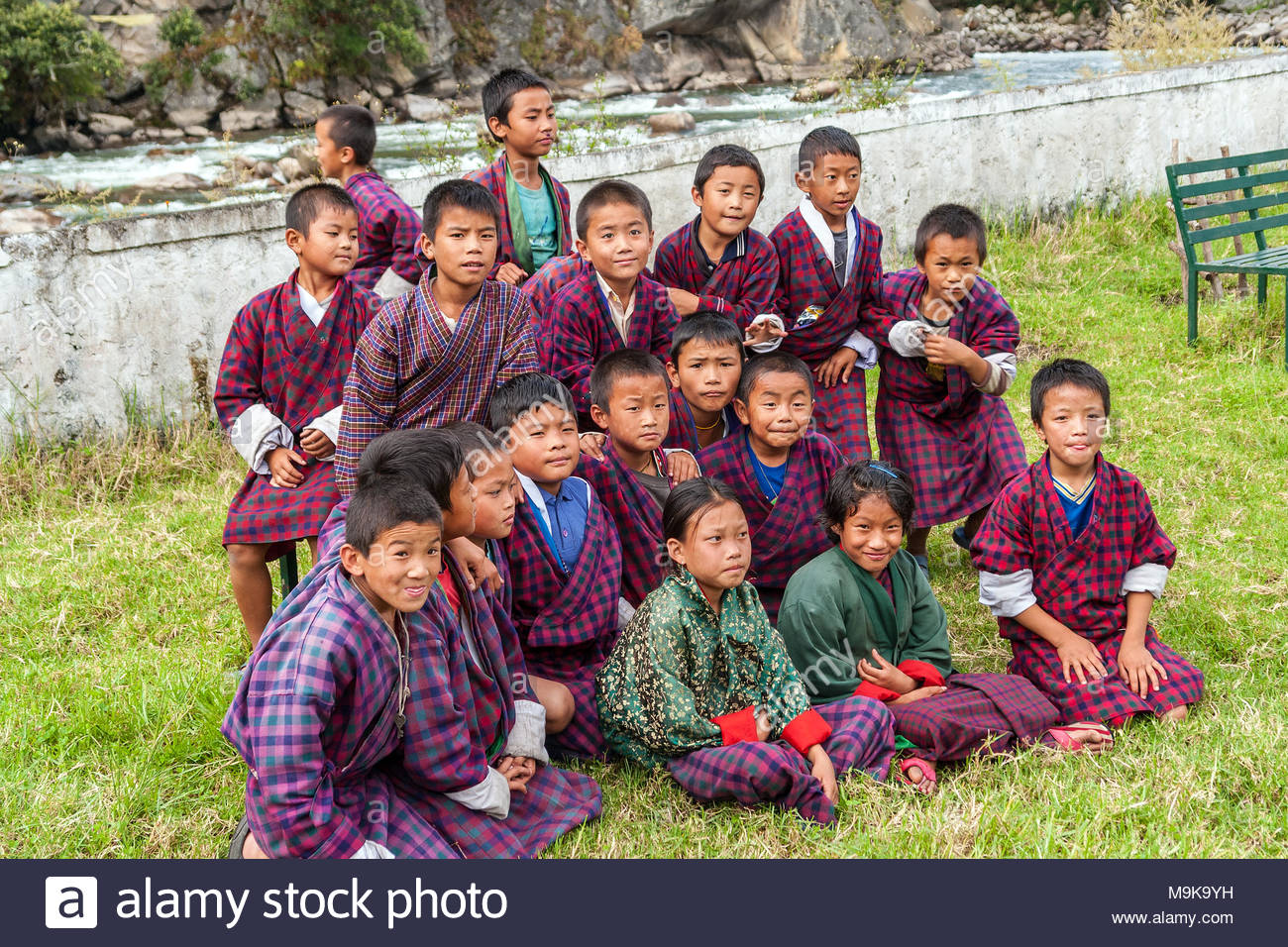 Group of Bhutanese children wearing the traditional dress - Eastern Bhutan - Stock Image