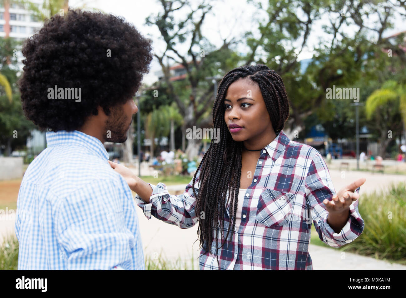 African american couple with relationship difficulties outdoors in the city - Stock Image