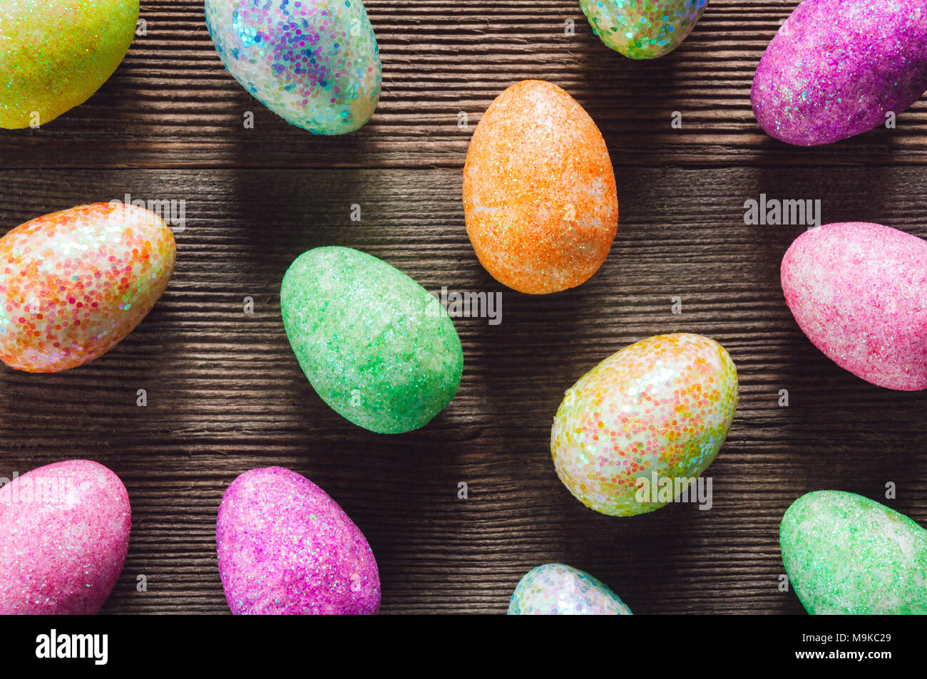 Colorful Eggs Arranged on Wood Table - Stock Image