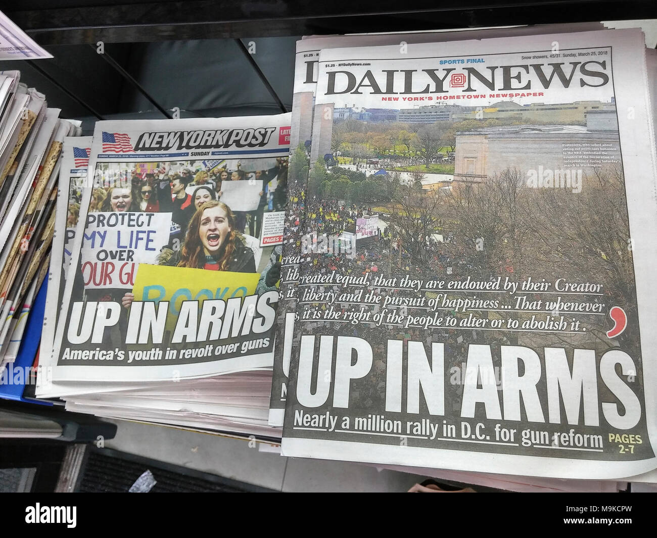"""Front pages of New York newspapers on Sunday, March 25, 2018 report on the previous days' """"March for Our Lives"""" rallies around the country and in Washington DC in response to the shooting at Marjory Stoneman Douglas High School in Parkland, Florida allegedly by 19 year-old Nikolas Cruz which left at least 17 dead. Both the intensely competitive New York Daily News and the New York Post use identical headlines. (© Richard B. Levine) Stock Photo"""