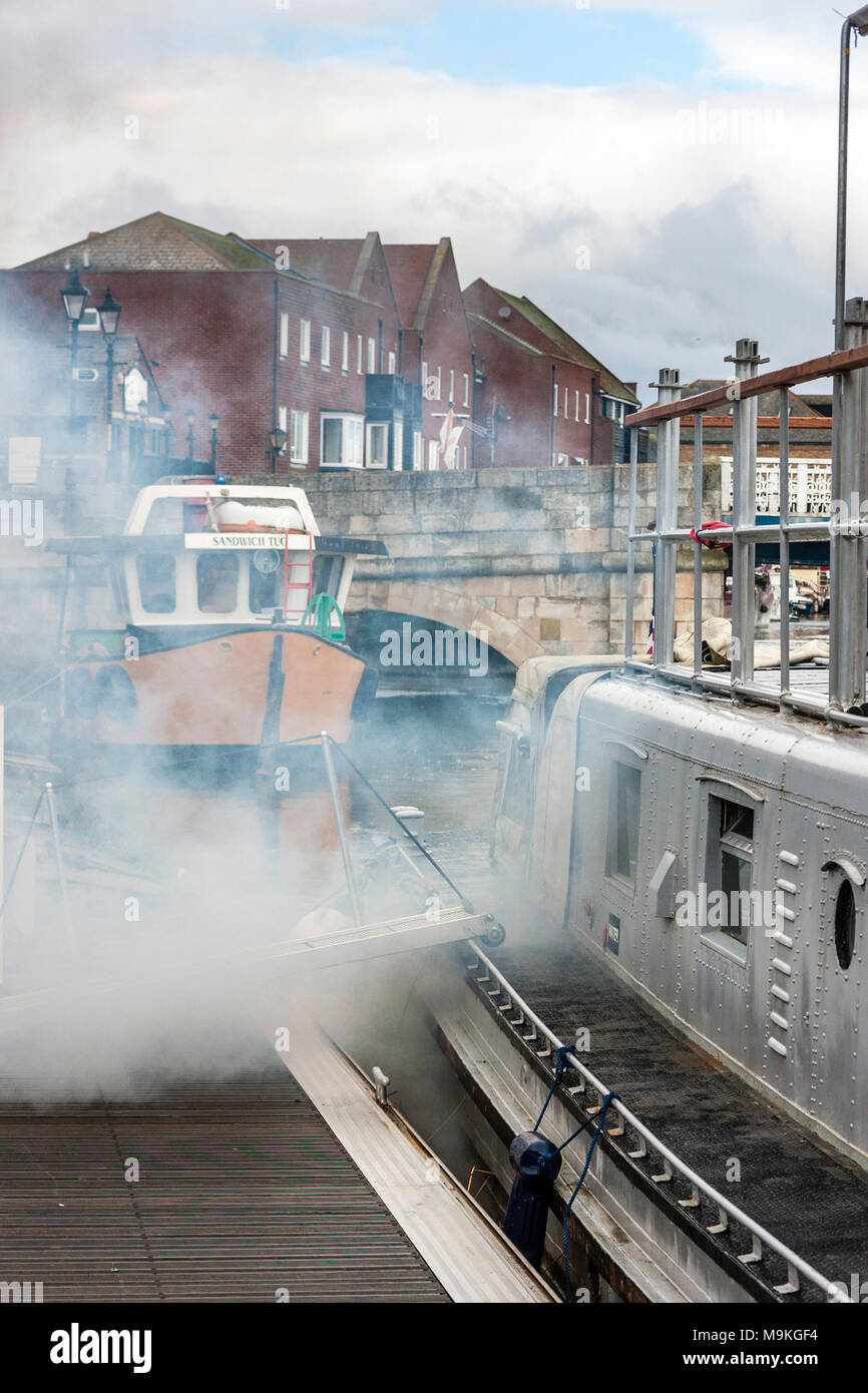 England, Sandwich. P22 US Navy patrol boat. Smoke pouring from outlets when engines started, pollution and high emissions. - Stock Image
