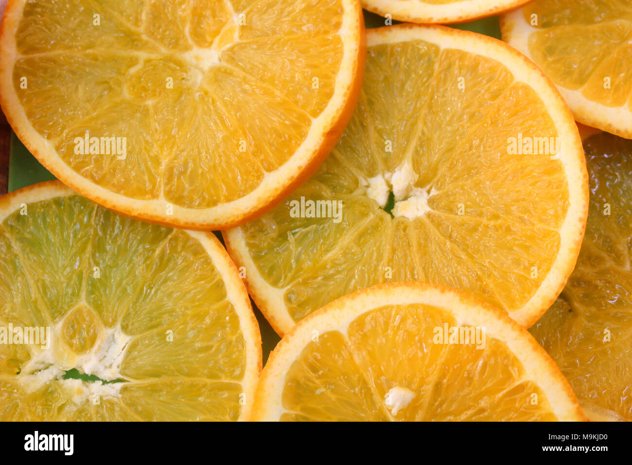 sliced oranges background top view - Stock Image