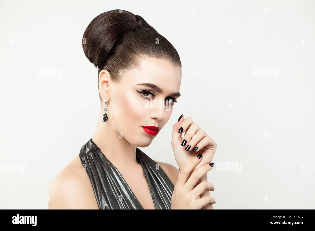 000b8b768 Stylish Woman showing Hands with Manicure Nails. Black Nail polish. Red Lips  and Eyeliner Makeup. Perfect Female Model Face